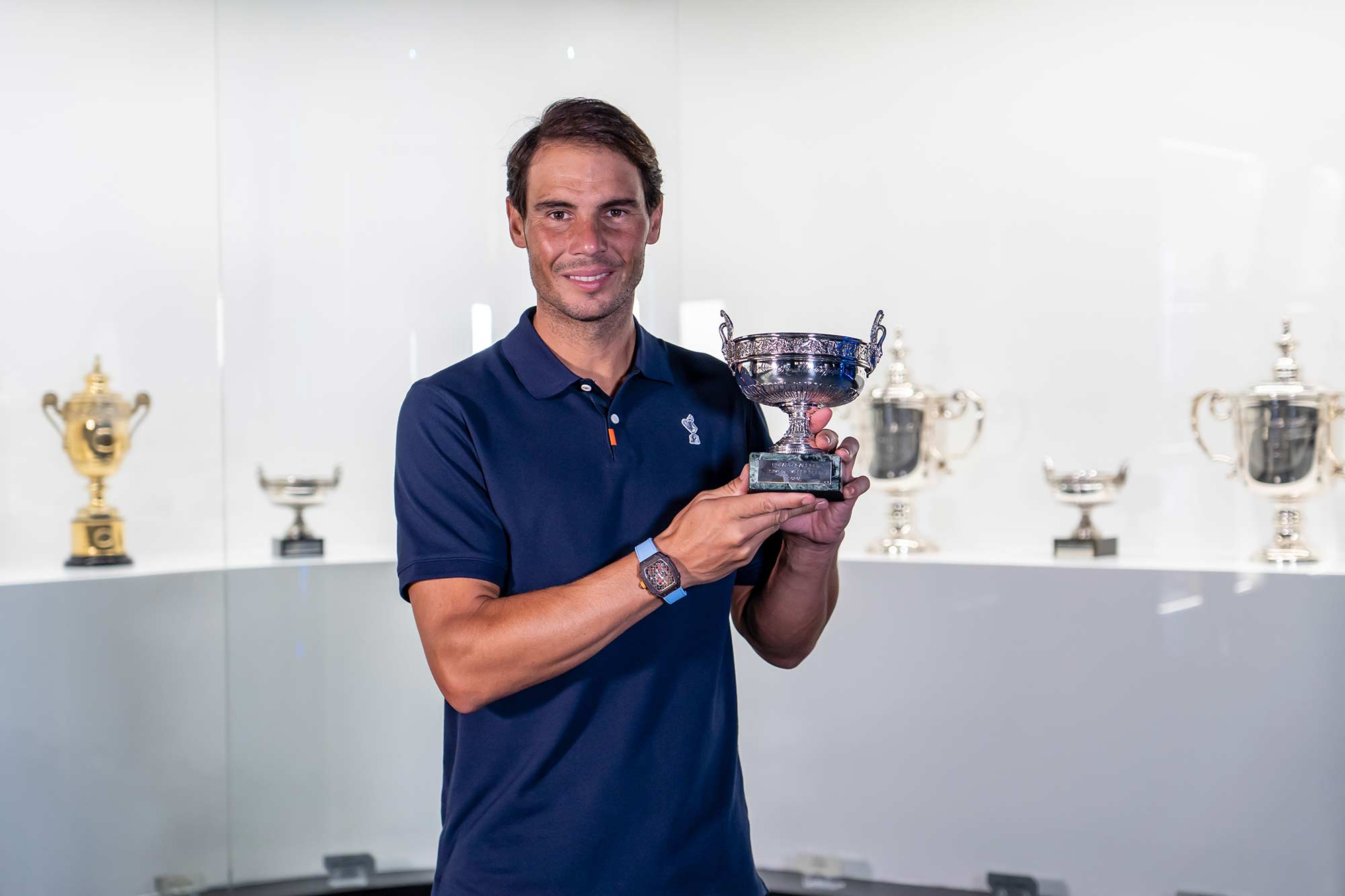 Rafa Nadal places his 20th Grand Slam trophy in the Rafa Nadal Museum